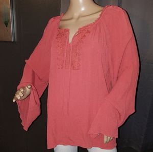 Salmon colored top with bell sleeves